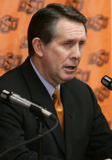 James Dickey, assistant college basketball coach at Oklahoma State University (OSU), makes a statement at a news conference in Stillwater, Okla., Wednesday, Feb. 15, 2006, following a telephone statement by head basketball coach Eddie Sutton, who acknowledged that he drank alcohol after taking medication for chronic back pain shortly before he was involved in a car accident last Friday.  (AP Photo/Sue Ogrocki)