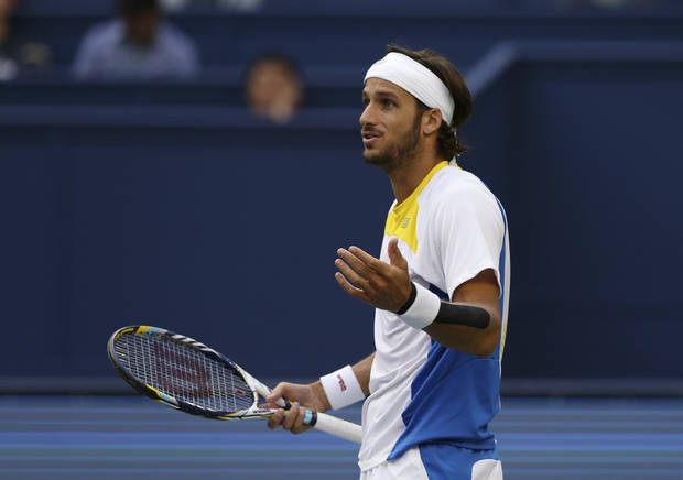 Feliciano Lopez of Spain reacts after losing a point to Novak Djokovic of Serbia during their third round men's singles match of the Shanghai Masters tennis tournament at Qizhong Forest Sports City Tennis Center in Shanghai, China, Thursday Oct. 11, 2012. Novak Djokovic won 6-3, 6-3. (AP Photo/Kin Cheung)