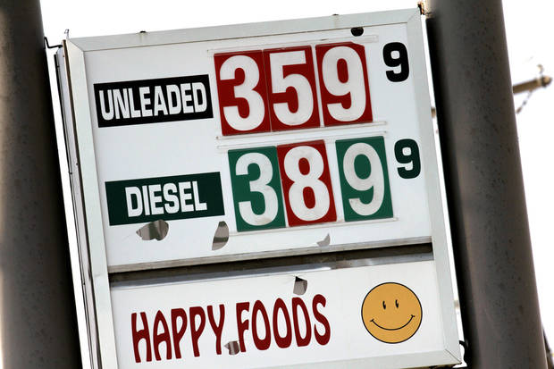 Gas prices are shown Tuesday at Happy Foods at Wilshire and Broadway Extension in Oklahoma City.   Photos by Doug Hoke, The Oklahoman