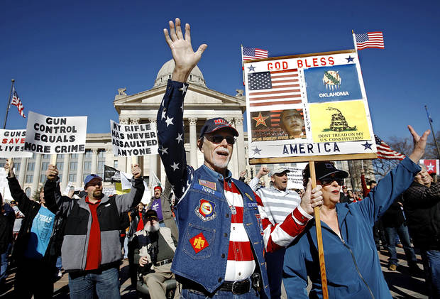 Ted Travis, of Guthrie, joins the crowd in a wave of support Saturday as rally participants gather for a photo at the state Capitol.  Photo by Jim Beckel, The Oklahoman