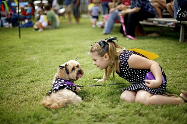 CHILD / CHILDREN / KIDS: Holly Heiner, 7, sits with her Lhasa apso , Taffy, during the Krazy Kids Dog Show in Edmond, Okla., Saturday, September 25, 2010.  Photo by Bryan Terry, The Oklahoman ORG XMIT: KOD