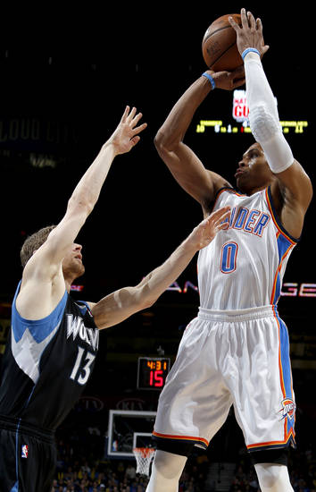 Oklahoma City's Russell Westbrook (0) takes a shot over Minnesota's Luke Ridnour (13) during an NBA basketball game between the Oklahoma City Thunder and the Minnesota Timberwolves at Chesapeake Energy Arena in Oklahoma City, Wednesday, Jan. 9, 2013.  Photo by Bryan Terry, The Oklahoman