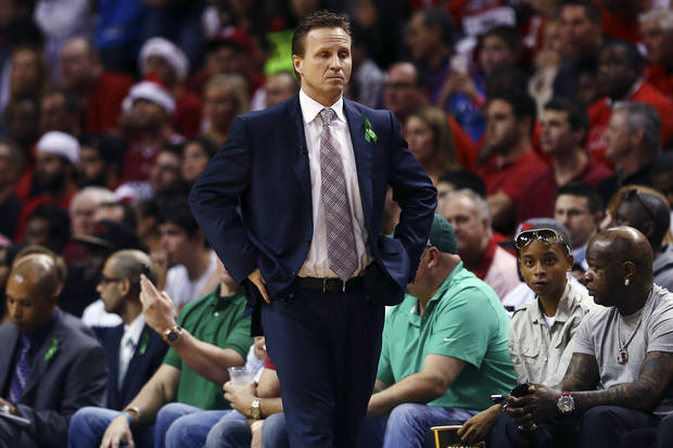 Oklahoma City Thunder head coach Scott Brooks reacts during the first half of an NBA basketball game against the Miami Heat, Tuesday, Dec. 25, 2012, in Miami. Rapper Birdman, bottom right, watches courtside. (AP Photo/J Pat Carter) ORG XMIT: FLJC108
