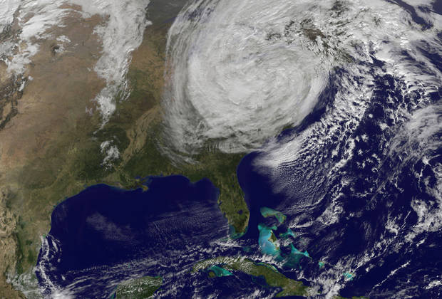 This handout photo provided by NOAA, taken Tuesday, Oct. 30, 2012, shows post-tropical storm Sandy off the East Coast of the US. Campaign 2012 is rich with images that conjure the seriousness and silliness that unfold side-by-side in any presidential race. Who could have predicted that a superstorm would overshadow and scramble the presidential campaign in its final days? President Barack Obama and Mitt Romney revised and re-revised their campaign schedules as Hurricane Sandy, a most unlikely October surprise, barreled up the East Coast and then roared ashore in New Jersey.  (AP Photo/NOAA) ORG XMIT: WX113