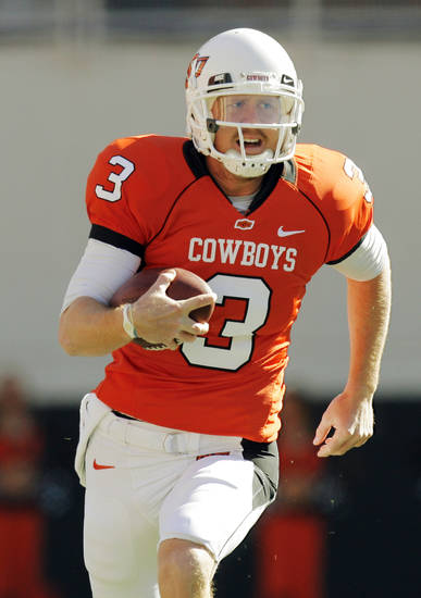 OSU quarterback Brandon Weeden (3) keeps the ball during the college football game between the Oklahoma State University Cowboys (OSU) and the Baylor University Bears at Boone Pickens Stadium in Stillwater, Okla., Saturday, Nov. 6, 2010. Photo by Nate Billings, The Oklahoman