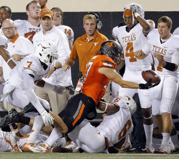 Oklahoma State's Charlie Moore (17) attempts to throw a lateral pass to end the game the college football game between Oklahoma State University (OSU) and the University of Texas (UT) at Boone Pickens Stadium in Stillwater, Okla., Saturday, Sept. 29, 2012. Texas on 41-36. Photo by Sarah Phipps, The Oklahoman
