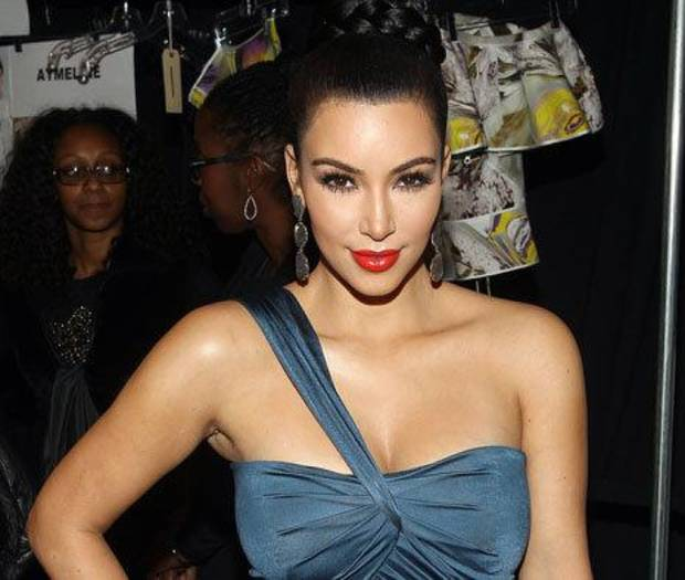 Kim Kardashian wears a shade of red lipstick with bluish undertones that compliments her olive skin tone. AP Photo. <strong>Donald Traill</strong>