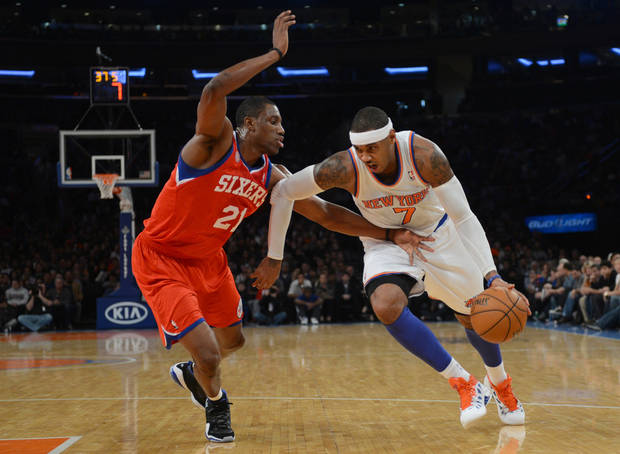 New York Knicks' Carmelo Anthony, right, drives on the Philadelphia 76ers' Thaddeus Young in the first quarter of the NBA basketball game at Madison Square Garden in New York, Sunday, Nov. 4, 2012. (AP Photo/Henny Ray Abrams)