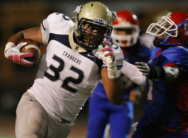 Heritage Hall's Quintaz Struble runs past John Marshall's Devion Smith during a high school football game at Taft Stadium in Oklahoma City, Thursday, Oct. 13, 2011, Photo by Bryan Terry, The Oklahoman ORG XMIT: KOD