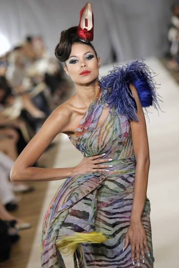 A model wears a creation by French fashion designer Eric Tibusch as part of his Haute Couture 2009-2010 fashion collection, in Paris, Tuesday July 7, 2009. (AP Photo/Thibault Camus) ORG XMIT: XTC109