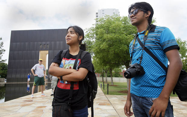 Priyam Goswami-Chaudhury, 20, from India, left, talks with Jiillure Rahim, 23, from Bangladesh, outside the Oklahoma City National Memorial and Museum on May 31, 2013. Photo by Aliki Dyer, The Oklahoman
