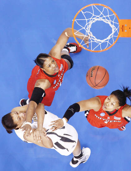 Purdue's Lindsay Wisdom-Hylton, left, scores a basket between Rutgers' Kia Vaughn, center, and Khadijah Rushdan during their NCAA women's basketball tournament game Sunday at the Ford Center.  PHOTO BY BRYAN TERRY, THE OKLAHOMAN
