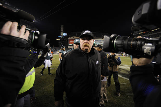Philadelphia Eagles head coach Andy Reid walks off the field past TV cameras after an NFL football game against the Cincinnati Bengals, Thursday, Dec. 13, 2012, in Philadelphia. Cincinnati won 34-13. (AP Photo/Michael Perez)