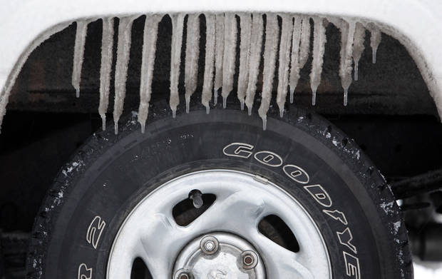 Icicles hang from a truck in a parking lot near Britton Rd. and May Ave. during a winter storm in Oklahoma City, Thursday, January 28, 2010. Photo by Nate Billings, The Oklahoman