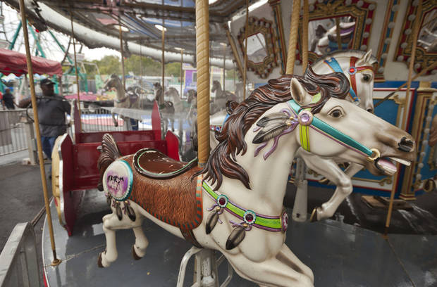 A man washes a carousel at the Arkansas State Fairgrounds in Little Rock, Ark., Thursday, Oct. 11, 2012. The fair is scheduled to open Friday, Oct. 12, and run through Oct. 21. (AP Photo/Danny Johnston)
