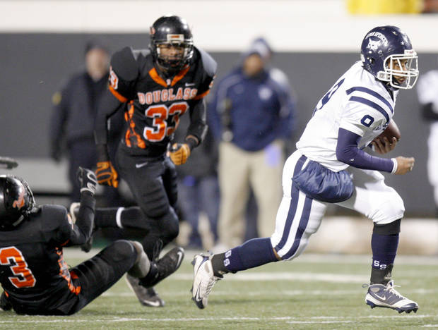 Franky Jamison of Star Spencer runs for touchdown past Aaron James, left, and Erik King of Douglass during the Class 4A high school football state championship game betweeen Star Spencer Douglass at Boone Pickens Stadium in Stillwater, Okla., Saturday, December 5, 2009. Photo by Bryan Terry, The Oklahoman