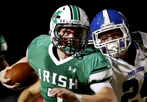 Irish quarterback Jacob Lewis escapes grasp of Deer Creek defender Kooper (cq) Ruminer on his way  into the end zone to score McGuinness' first touchdown on this second quarter play. Deer Creek Antlers vs. Bishop McGuinness Fighting Irish at Pribil Stadium Friday night, Nov. 2, 2012.    Photo by Jim Beckel, The Oklahoman