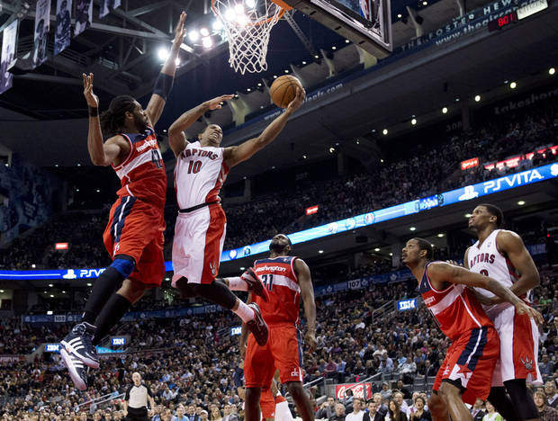 Toronto Raptors guard DeMar DeRozan (10) drives to the basket against Washington Wizards center Nene (42) as Wizards forwards Chris Singleton (31) and Trevor Ariza (1) watch while boxing out Raptors forward Rudy Gay, right, during the first half of their NBA basketball game, Monday, Feb. 25, 2013, in Toronto. (AP Photo/The Canadian Press, Frank Gunn)