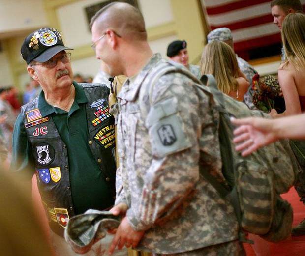 J.C. Humphries, a Vietnam Veteran, welcomes soldiers home during a ceremony for soldiers returning from Iraq at Fort Sill on Tuesday, June 8, 2010. Members of the Vietnam Veterans of America Chapter 751, have been to every deployment and return since Sept. 11, 2001. Photo by John Clanton, The Oklahoman ORG XMIT: KOD