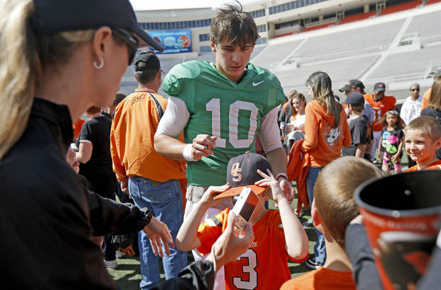 Oklahoma State's Clint Chelf signs autographs after OSU's spring football game at Boone Pickens Stadium in Stillwater, Okla., Sat., April 20, 2013. Photo by Bryan Terry, The Oklahoman