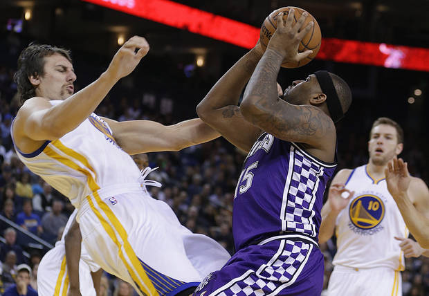 Sacramento Kings' DeMarcus Cousins (15) collides with Golden State Warriors' Andrew Bogut, left, during the first half of an NBA basketball game Wednesday, March 6, 2013, in Oakland, Calif. (AP Photo/Ben Margot)
