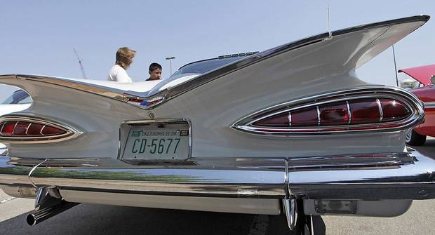 Donna and Brandon Krist look at an original, unrestored 1959 Chevy Impala Sport Coupe with 50,000 miles owned by Dennis and Sharon Doughty of Edmond at the LibertyFest Car Show on the campus of UCO Saturday, June 27, 2009. Photo by Doug Hoke, The Oklahoman.