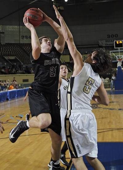 Sequoyah's Trinton Herron (21) shoots over Okemah's Rance McIntyre (5) during the state high school basketball tournament Class 3A boys semifinal game between Okemah High School and Sequoyah High School at the State Fair Arena on Friday, March 8, 2013, in Oklahoma City, Okla. Photo by Chris Landsberger, The Oklahoman