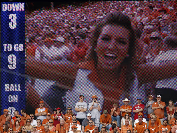 Fans watch during the Red River Rivalry college football game between the University of Oklahoma Sooners (OU) and the University of Texas Longhorns (UT) at the Cotton Bowl in Dallas, Saturday, Oct. 8, 2011. Oklahoma won 55-17 Photo by Bryan Terry, The Oklahoman