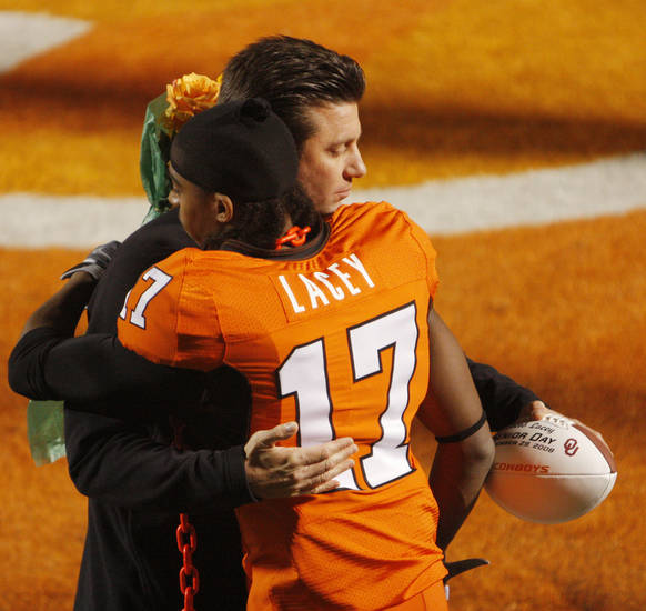 OSU head coach Mike Gundy gives Jacob Lacey a hug as he is introduced for his last game before college football game between the University of Oklahoma Sooners (OU) and Oklahoma State University Cowboys (OSU) at Boone Pickens Stadium on Saturday, Nov. 29, 2008, in Stillwater, Okla. STAFF PHOTO BY DOUG HOKE