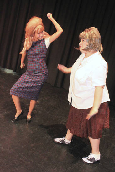 Brooke Bradley, as Penny, and Alyssa Boston, as Tracy, rehearse for the Harding Fine Arts Academy drama department production of �Hairspray.�  Photo provided by Harding Fine Arts Academy