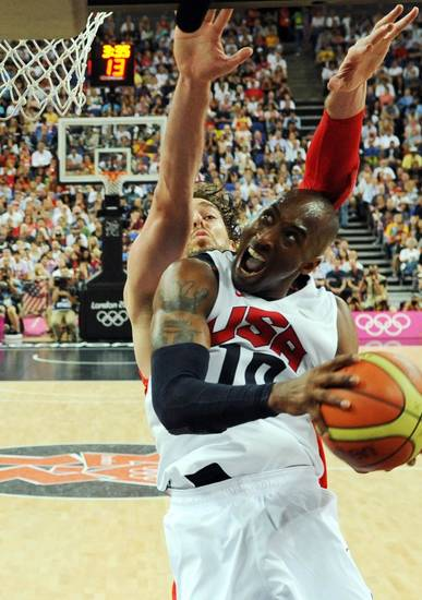 The United States' Kobe Bryant jumps to score during the men's gold medal basketball game at the 2012 Summer Olympics in London on Sunday, Aug. 12, 2012. (AP Photo/Mark Ralston, Pool)