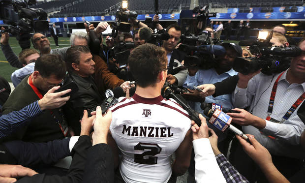 Texas A&M quarterback Johnny Manziel (2) talks to reporters during media day for the Cotton Bowl Classic NCAA college football game at Cowboys Stadium, Sunday, Dec. 30, 2012, in Arlington, Texas. Oklahoma and Texas A&M are scheduled to play on Jan. 4, 2013. (AP Photo/LM Otero)