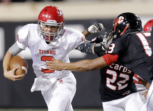 Carl Albert's Steven Thompson (3) runs past East Central's Warren Walker (13)  during the Class 5A Oklahoma state championship football game between Carl Albert High School and Tulsa East Central High School at Boone Pickens Stadium on Saturday, Dec. 1, 2012, in Stillwater, Okla.   Photo by Chris Landsberger, The Oklahoman
