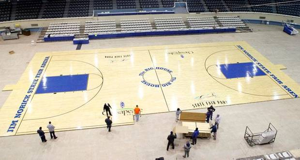 In a view from the catwalk, workers assemble the Big House floor at State Fair Arena in preparation for the state high school basketball championships, in Oklahoma City, Monday, March 2, 2009. BY NATE BILLINGS, THE OKLAHOMAN
