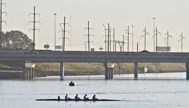 Competitors are lit by the morning sun as they warm up before competing during the Oklahoma Regatta Festival at the Oklahoma River on Saturday, Oct. 1, 2011, in Oklahoma City, Okla. Photo by Chris Landsberger, The Oklahoman