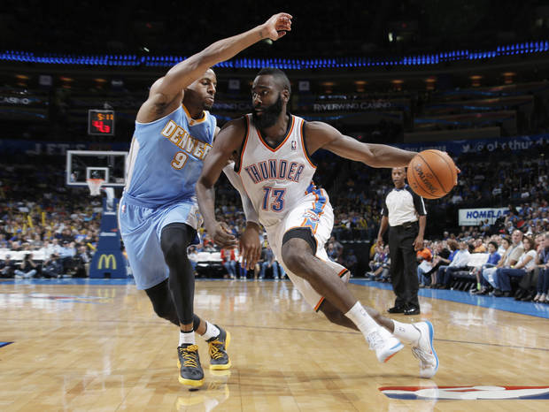 Oklahoma City's James Harden (13) drives the ball past Denver's Ty Lawson (3) during the NBA preseason basketball game between the Oklahoma City Thunder and the Denver Nuggets at the Chesapeake Energy Arena, Sunday, Oct. 21, 2012. Photo by Garett Fisbeck, The Oklahoman