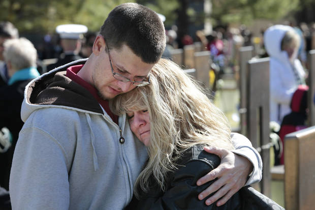 Matthew Mahan comforts his mother Dawn Mahan at her mother Frances Williams' chair during the 18th Anniversary Remembrance Ceremony at the Oklahoma City National Memorial and Museum, Friday, April 19, 2013. Photo By David McDaniel/The Oklahoman