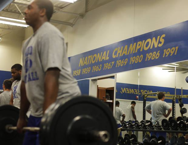 COLLEGE FOOTBALL: NEO teammates do strength training at Northeastern Oklahoma A&M College in Miami, Okla., Wednesday, July 18, 2012.  Photo by Garett Fisbeck, The Oklahoman