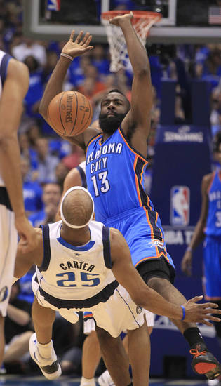 Oklahoma City Thunder guard James Harden (13) looses control of the ball when he drives into Dallas Mavericks shooting guard Vince Carter (25) during the first half of Game 4 in a first-round NBA basketball playoff series, Saturday, May 5, 2012, in Dallas. (AP Photo/LM Otero)