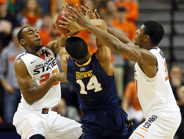 Oklahoma State's Markel Brown (22), left, and Marcus Smart (33) pressure West Virginia's Gary Browne (14) during an NCAA men's basketball game between Oklahoma State University (OSU) and West Virginia at Gallagher-Iba Arena in Stillwater, Okla., Saturday, Jan. 26, 2013. Oklahoma State won, 80-66. Photo by Nate Billings, The Oklahoman