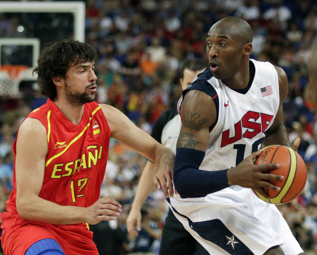 United States&#039; Kobe Bryant tries to drive on Spain&#039;s Sergio Llull during the men&#039;s gold medal basketball game at the 2012 Summer Olympics, Sunday, Aug. 12, 2012, in London. (AP Photo/Charles Krupa)