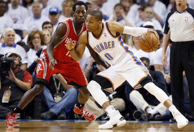 Oklahoma City's Russell Westbrook (0) works against Houston's Patrick Beverley (12) during Game 2 in the first round of the NBA playoffs between the Oklahoma City Thunder and the Houston Rockets at Chesapeake Energy Arena in Oklahoma City, Wednesday, April 24, 2013. Photo by Nate Billings, The Oklahoman