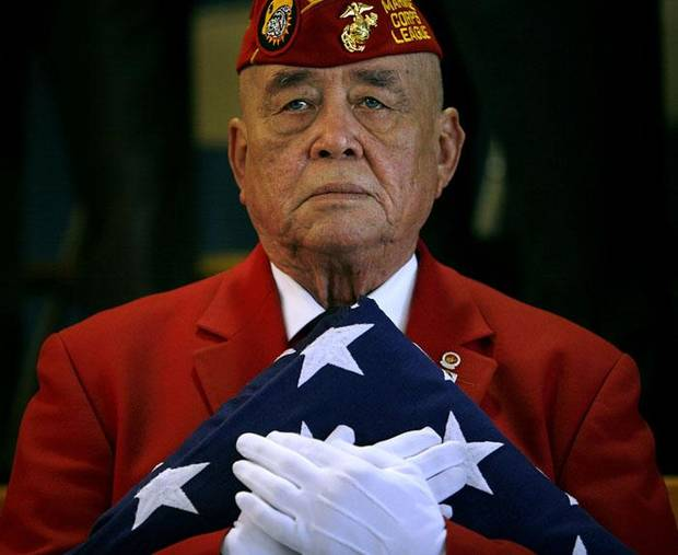 Marine Corps League Member Keith Howry holds an American flag during a presentation by the group at Johnson Elementary in Oklahoma City on Wednesday, Nov. 11, 2009. By John Clanton, The Oklahoman ORG XMIT: KOD
