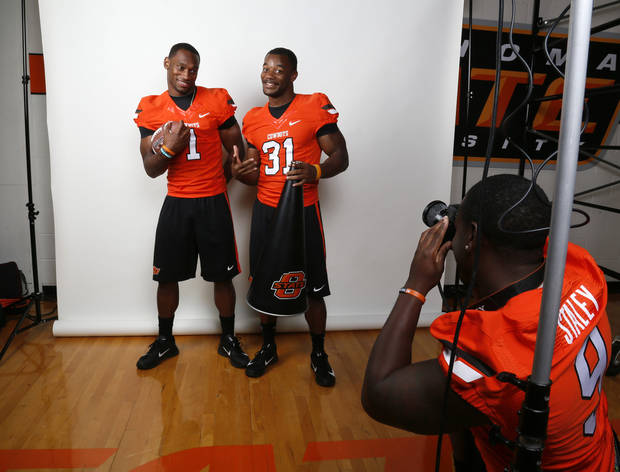 OSU's Kye Staley, right, takes a picture of Joseph Randle, left, and Jeremy Smith as they joke around during a photo shoot at media day for the OSU football team at Gallagher-Iba Arena in Stillwater, Okla., Saturday, Aug. 4, 2012. Photo by Nate Billings, The Oklahoman