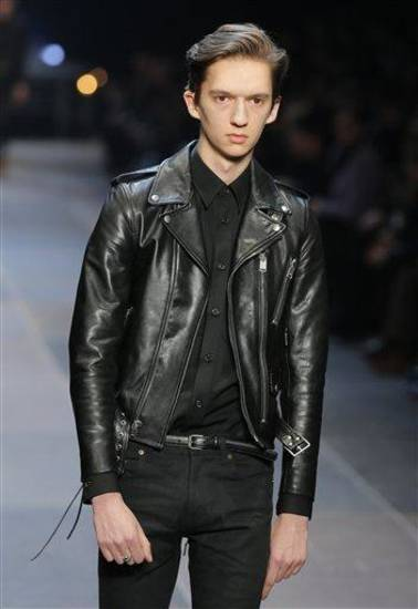 A model wears a creation by Born French fashion designer Hedi Slimane for St Laurent   as part of the Men's fall-winter 2013-2014 fashion collection presented in Paris, Sunday , Jan. 20 2013 (AP Photo/ Jacques Brinon)