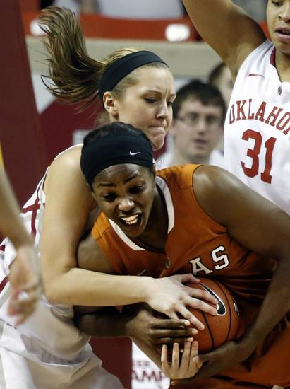Oklahoma Sooners' Nicole Kornet, back, ties up Texas Longhorn's Nneka Enemkpali (3) in the second half as the University of Oklahoma Sooners (OU) defeat the University of Texas (UT) Longhorns 69-56 in NCAA, women's college basketball at The Lloyd Noble Center on Saturday, Jan. 19, 2013 in Norman, Okla. Photo by Steve Sisney, The Oklahoman