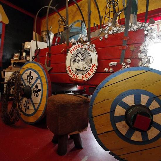 A colorful  wagon decorating the inside of French Cowgirl.  Photo by, Aliki Dyer, The Oklahoman