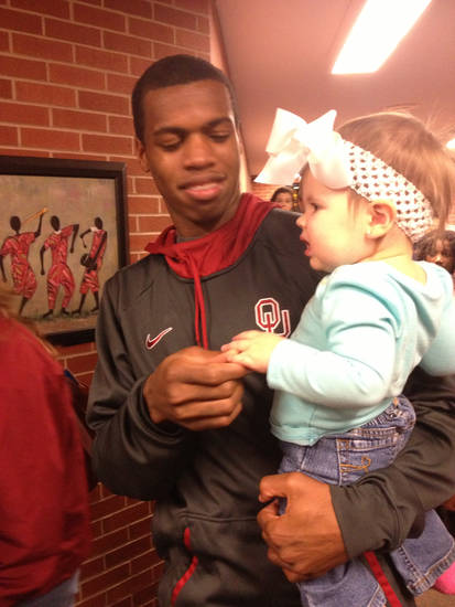 Oklahoma men's basketball guard Buddy Hield and a little Sooner fan named Kayleigh