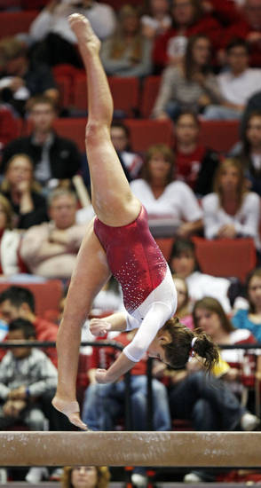 OU's Taylor Spears competes on the beam during the Beauty and the Beast event at the Lloyd Noble Center in Norman, Okla., where the University of Oklahoma wrestling team competed against Virginia Tech and the OU women's gymnastics team competed against North Carolina State, Friday, Jan. 27, 2012. Photo by Nate Billings, The Oklahoman