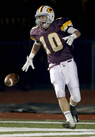 Clinton&#039;s Quinton Hand celebrates an interception for touchdown during the high school playoff game between Ada and Clinton at Putnam City High School in Oklahoma City, Friday, Nov. 23, 2012. Photo by Sarah Phipps, The Oklahoman